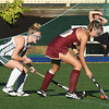 BRYAN EATON/Staff photo. Newburyport's Callie Beauparlant gets the ball away from Pentucket's Audra Foster.