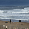 BRYAN EATON/Staff photo. Strong winds continued into Monday blowing the tops of the rolling waves at Salisbury Beach.