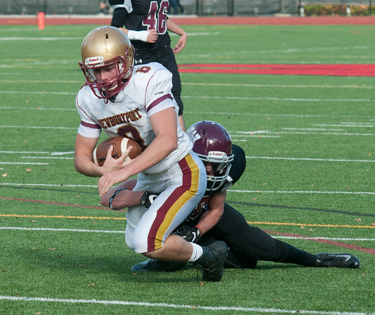 JIM VAIKNORAS/Staff photo Newburyport's Robert Johnson hauls in a pass against Weston at Wellesley High School Saturday.
