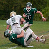 JIM VAIKNORAS/Staff photo Pentucket's Ethan Doore throws  North Reading Ryan Kavanaugh for a loss during their game at Pentucket Saturday.