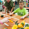 JIM VAIKNORAS/Staff photo Logan Judd, 8, and Mikey McGowan, 8, play tic tac toe with gourds at a Lights On After School event at Amesbury Elementary School Thursday night celebrating the achievements of after school students and draw attention to the need for more after school. Along with game kids and their parents enjoyed decorating, along with pizza and donuts.