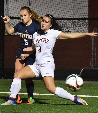 BRYAN EATON/Staff photo. Newburyport's Sami Kelleher tries to stop the ball from going out of bounds.