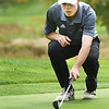 BRYAN EATON/Staff photo. Newburyport's Michael Twomey lines up a putt.