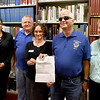 BRYAN EATON/Staff photo. Local historian Ghlee Woodworth recently spoke at the meeting of the Newburyport Lion's Club and they were looking for an institution to donate $200 to. She offered the Archival Center at the Newburyport Public Library. From left, assistant archivist Dana Echelberger, club board member David Sheppard, archivist Sharon Spieldenner, recieving the check from club president Stephen Baran and Woodworth.