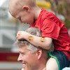 JIM VAIKNORAS/Staff photo  Tommy Cook ,4,sits on his dad Tom's shoulders as a convoy of more than 70 trucks make their way past his house on Meadowview Road in Georgetown Saturday afternoon. Tommy's family and friends throw him a party to celebrate his liver cancer going into remission. Along with the trucks, there was food, games, presents, and a visit from Bruin's mascot Blades.