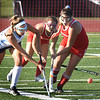 BRYAN EATON/Staff photo. Gianna Conte and Masconomet's DePiettrantonio go for the battle for control.