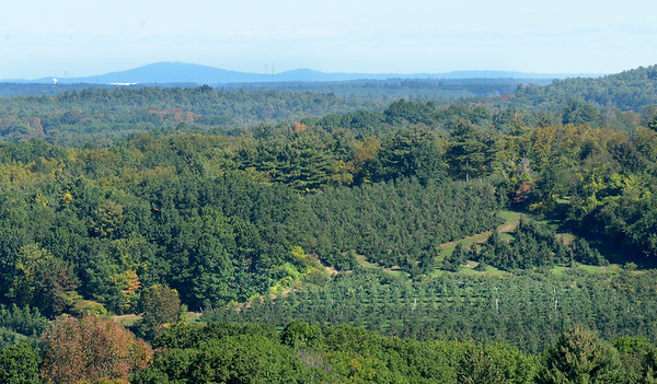 BRYAN EATON/Staff photo. The skies were clear in the early part of Tuesday before clouds started to move in. Mount Agamenticus in southern Maine can be seen to upper left, over the apple orchards at Cider Hill Farm in Amesbury in a view from Powow Hill.