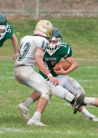 JIM VAIKNORAS/Staff photo Pentucket's Andrew Joyce makes a move against North Reading at Pentucket Saturday
