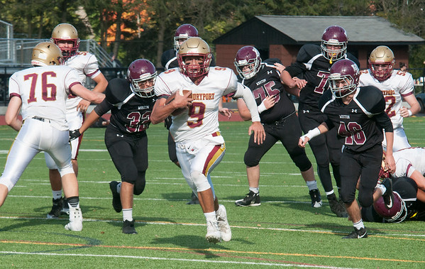 JIM VAIKNORAS/Staff photo Newburyport's Myles Maloof runs for a touchdown against Weston at Wellesley High School Saturday.