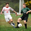BRYAN EATON/Staff photo. Amesbury's Sinjon Holmes moves in on Jack Queenan.