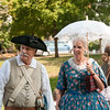 JIM VAIKNORAS/Staff photo Tom and Linda Kolterjahn dressed in period garb enjoy a stroll at Bartlet Mall Day Saturday on the Mall in Newburyport.