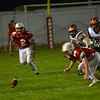 JIM VAIKNORAS/Staff photo Amesbury's #52 Jacob Hamel and #2 Zachary Levarity go after a fumble which Hamel recovered  against Ipswich Friday night at Landry Stadium in Amesbury.