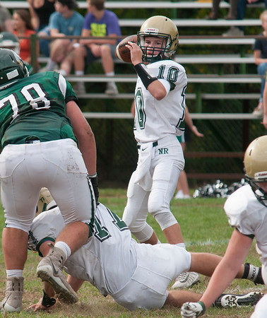 JIM VAIKNORAS/Staff photo North Reading's Aidan Carucci looks down field for a receiver at Pentucket Saturday.