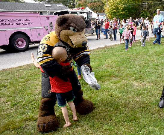 JIM VAIKNORAS/Staff photo  Tommy Cook ,4,hugs  Bruin's mascot Blades, at his house on Meadowview Road in Georgetown Saturday afternoon. Tommy's family and friends throw him a party to celebrate his liver cancer going into remission. Along with Blades over 70 trucks drove by his house to help him celebrate.