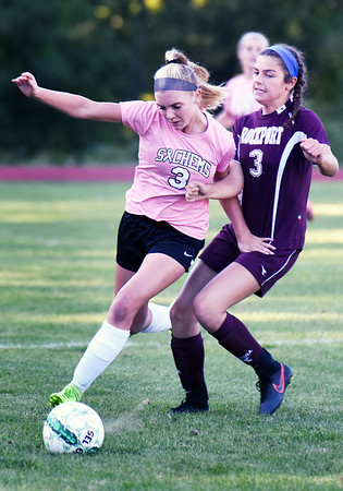 BRYAN EATON/Staff photo. Ali Ketchopulos puts the pressure on Pentucket's Anna Wyner.