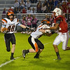 JIM VAIKNORAS/Staff photo Ipswich player Izzy Morrissey returns a kick at Amesbury Friday night.