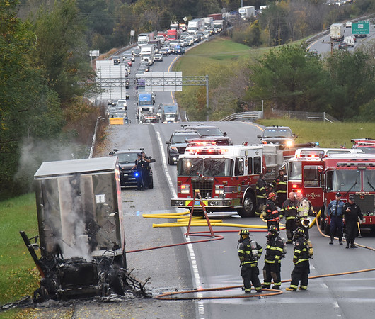 BRYAN EATON/Staff photo. Firefighters tackled a tractor trailer fire on Insterstate 495 northbound in Amesbury on Monday morning. The cab of the rig was destroyed and traffic was backed up and diverted.