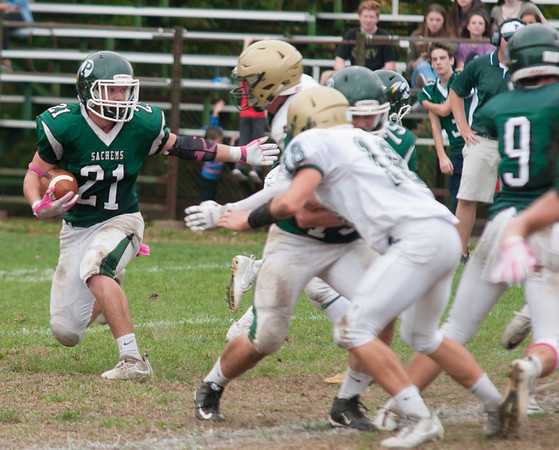 JIM VAIKNORAS/Staff photo Pentucket's Brandon Wilbur looks for running room against North Reading during their game at Pentucket Saturday.