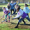 BRYAN EATON/Staff photo. Amesbury Middle School students practice field hockey at the Amesbury Town Park.