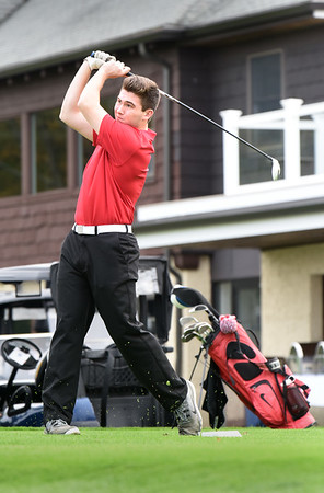 BRYAN EATON/Staff photo. Amesbury's Zach Labrecgue tees off.
