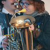 JIM VAIKNORAS/Staff photo Alison Earnhart plays the tornister or travel tuba with the Emperor Norton's Stationary Marching Band at the American Music & Harvest Festival at the Spencer-Peirce-Little Farm in Newbury on Saturday. The event which featured band throughout the day, benefited area education foundations.