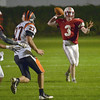 JIM VAIKNORAS/Staff photo Amesbury's quarterback Black Bennett looks for a receiver against Ipswich Friday night at Landry Stadium in Amesbury.