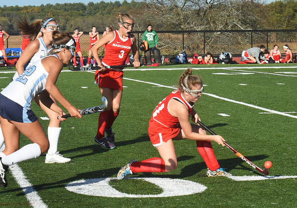 BRYAN EATON/Staff photo. Triton's Gianna Conte rushes in to try to capitalize on Masco's Zagmagni.