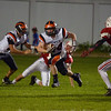 JIM VAIKNORAS/Staff photo Ipswich back Pat Gillis runs for yardage at Amesbury Friday night.