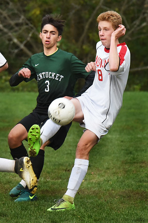 BRYAN EATON/Staff photo. Amesbury's Leif Riley kicks the ball away from Pentucket's Jake Correnti.
