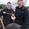 JIM VAIKNORAS/Staff photo Ashley and Walter Lowell of Newburyport Towing serve chili at the Annual Amesbury Firefighters Chili Cook-off Saturday at the Friend Street parking lot.