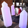 "BRYAN EATON/Staff photo. John Lyons checks out ""portal"" built by associate professor of Interactive Media at Becker College, Derek Hoffend who was a guest of Inventive Labs and CI Works in Amesbury. It is a sculptural installation combining sound, colored light and constructed forms to create a zone for repose and relaxation."