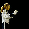 JIM VAIKNORAS/Staff photo Triton Marching Band Drum Major Gabby Doucot conducts the band Friday night at half time of the Viking's game at home against Newburyport.