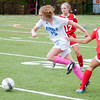 JIM VAIKNORAS/Staff photo Georgetown's Lilija Knapp splits 2 Amesbury defenders during their game at Georgetown Thursday.