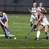 BRYAN EATON/Staff photo. Triton's Riane Vatcher moves down field as Callie Beauparlant moves to block.
