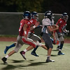 JIM VAIKNORAS/Staff photo Triton's Christian O'Brien out runs Somerville defenders at Dilboy Stadium in Somerville Friday night.