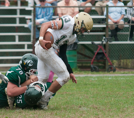 JIM VAIKNORAS/Staff photo Pentucket's #25 Korey Sheffen and #78 Jacob Luke tackle  North Reading's Jake Bedell during their game at Pentucket Saturday.