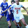 BRYAN EATON/Staff photo. Georgetown's Mary Laut and Amesbury's Alyssa Pettet vie for the ball.