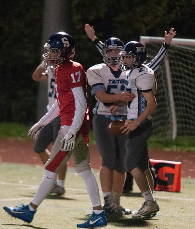 JIM VAIKNORAS/Staff photo Triton's Cody Crocker hugs teammate Kyle Oday after Oday's touchdown against Somerville at Dilboy Stadium in Somerville Friday night.