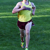BRYAN EATON/Staff photo. Newburyport's Sam Aquaviva wins in the boys race.