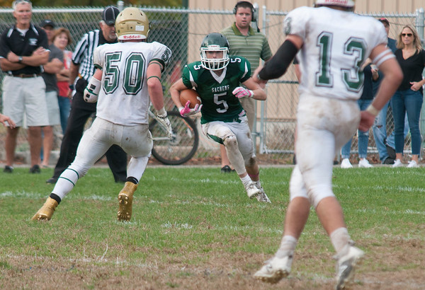 JIM VAIKNORAS/Staff photo Pentucket's Jake Etter looks for running room against North Reading at Pentucket Saturday