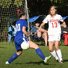 BRYAN EATON/Staff photo. Amesbury's Sophie Carter kicks the ball past Sarah Mabius.