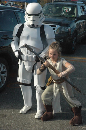 DAVE ROGERS/Staff photo Dressed up as Rey from Star Wars, Gianna LeBlanc, 7, of Amesbury poses with a Stormtrooper at Saturday's Newburyport Trunk or treat event at the New England Sports Park. LeBlanc was one of more than 750 children who attended the free event.