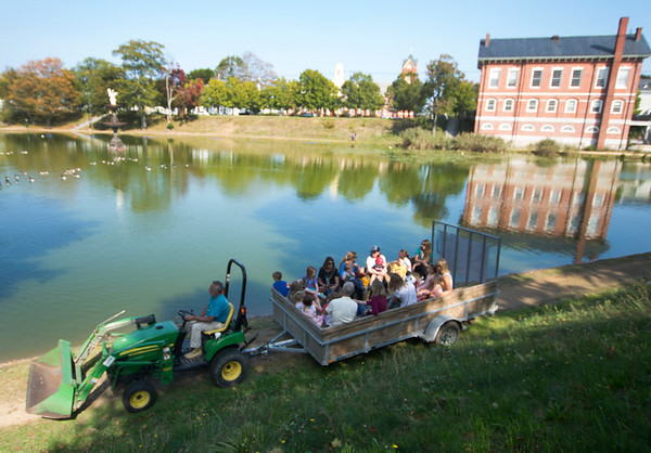 JIM VAIKNORAS/Staff photo people enjoy a tractor ride around the Frog Pond at Bartlet Mall Day Saturday on the Mall in Newburyport.