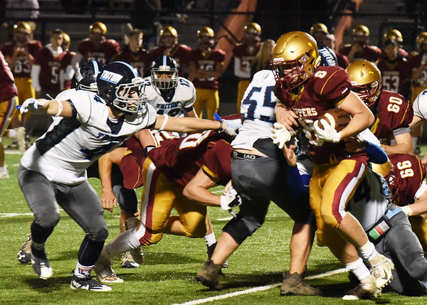 BRYAN EATON/Staff photo. Arms outstretched, Triton's Charles Takesian is ready to tackle Robert Johnston.