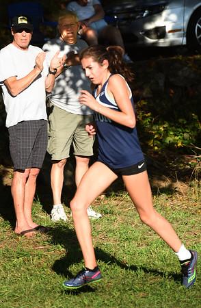 BRYAN EATON/Staff photo. Triton's Ellie Gay-Killeen crosses the finish line.