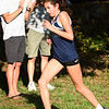 BRYAN EATON/Staff photo. Triton's Ellie Gay-Killeen crosses the finish line.
