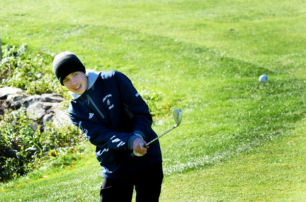 BRYAN EATON/Staff photo. Triton's Nick Ritchie hits from the green.