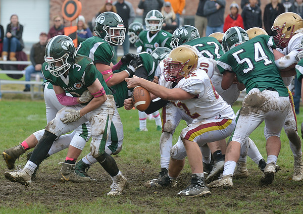JIM VAIKNORAS/Staff photo Pentucket's Jake Beland has the ball stripped by Newburyport's Ralph Woekel during their game at Pentucket Saturday.