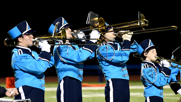 JIM VAIKNORAS/Staff photo The trombone section performs with the Triton High School band at Friday night football game against North Reading.