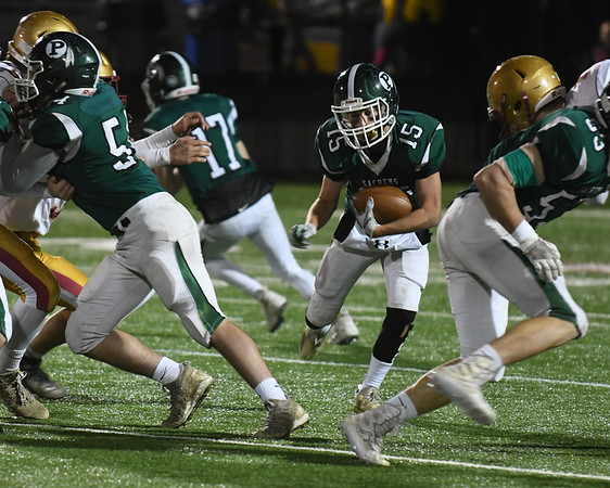JIM VAIKNORAS/Staff photo Pentucket's Andrew Joyce runs through a hole against Newburyport during their game Friday night at World War Memorial Stadium in Newburyport.